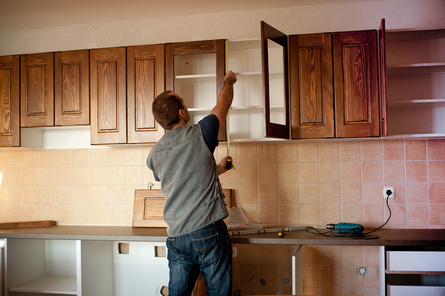 carpenter with cabinet